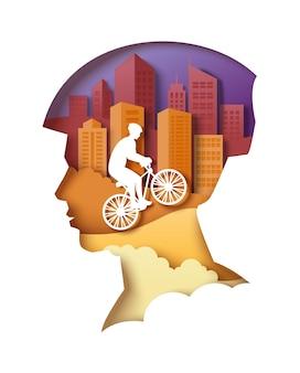 Sylwetka głowy mężczyzny z budynkami miejskimi i rowerzystą wektor wycinany z papieru ilustracja miasto eko tra...