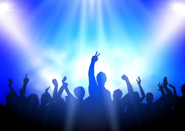 Sylwetka imprezowej publiczności na tle reflektorów