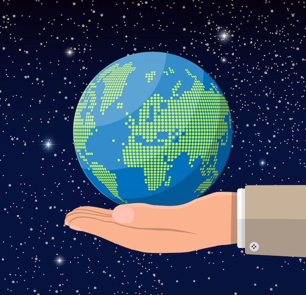 Sylwetka mapy świata w ręku. glob kropki w przestrzeni