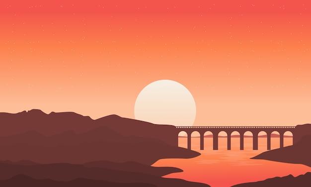 Sylwetka most na rzecznych tło