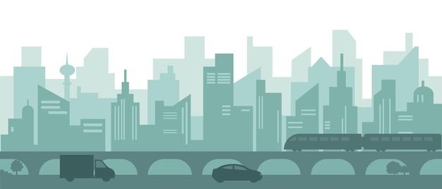 Sylwetka nowoczesnego miasta z wieżowcami, samochodami i pociągiem metra.