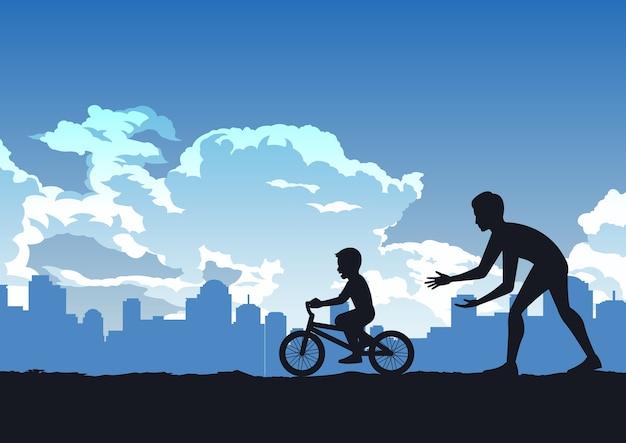 Sylwetka ojca uczy syna jeździć na rowerze