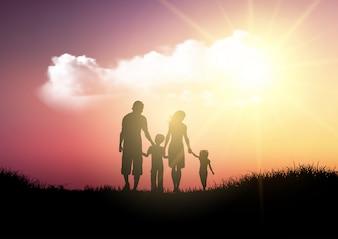 Sylwetka rodzinny odprowadzenie przeciw zmierzchu niebu