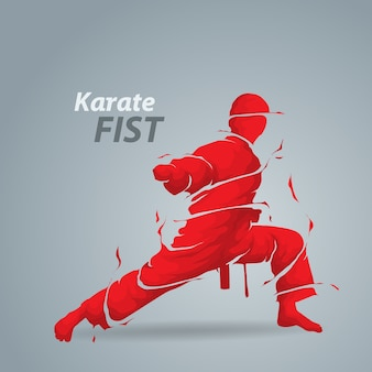 Sylwetka rozpryskiwania karate pięść
