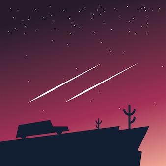 Sylwetka samochodu w górach w nocy z projektowaniem spadających gwiazd, krajobrazem przyrody i motywem zewnętrznym
