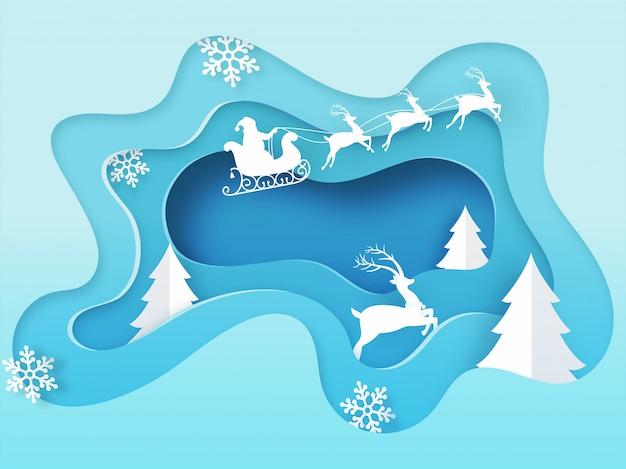 Sylwetka świętego mikołaja jedzie na saniach z reniferem, płatkiem śniegu i drzewem świątecznym na niebieskiej warstwie papieru wyciąć tło na obchody wesołych świąt