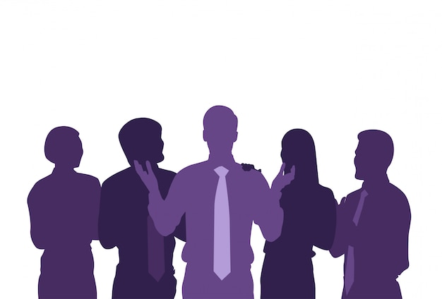Sylwetka szefa z zespołem ludzi biznesu na białym tle. grupa przedsiębiorców