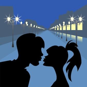 Sylwetki całują dziewczynę i chłopaka na tle wieczornego bulwaru z lampionami