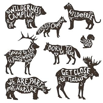 Sylwetki dzikich zwierząt z napisem