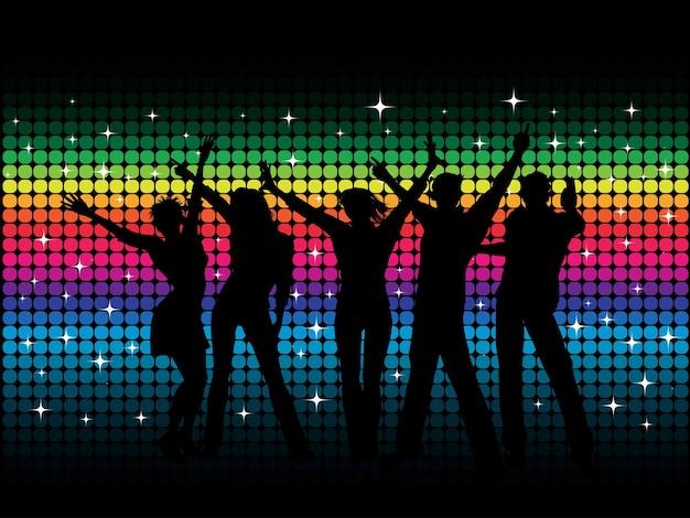 Sylwetki ludzi tańczących na tle disco