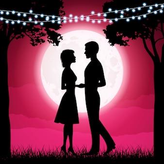 Sylwetki młodej kobiety i mężczyzny na tle księżyca