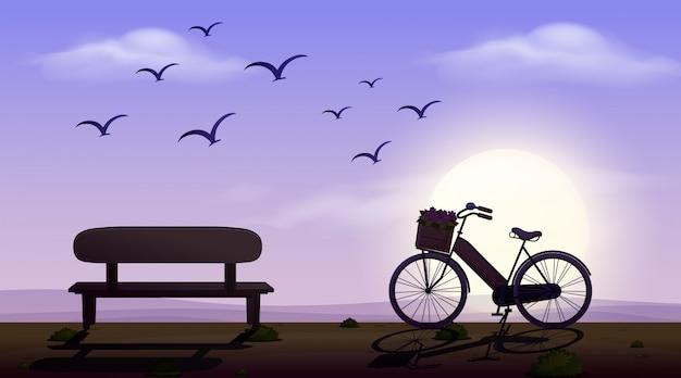 Sylwetki scena z siedzeniem i bicyklem na drodze