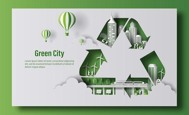 Symbol recyklingu z zielonym miastem w stylu papieru