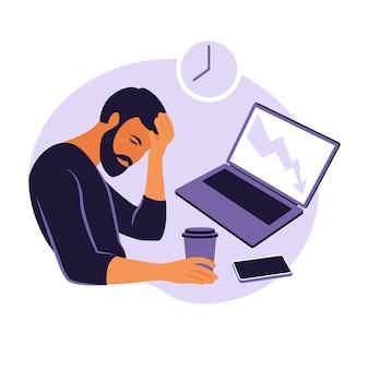 Syndrom wypalenia zawodowego. zmęczony pracownik biurowy siedzi przy stole. sfrustrowany pracownik, problemy ze zdrowiem psychicznym.