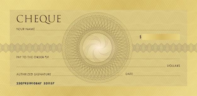 Szablon czeku lub czekowej. pusty złoty biznes czek bankowy z rozetą giloszową i abstrakcyjnym znakiem wodnym.