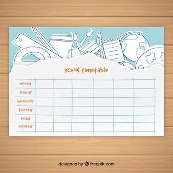 Szablon kalendarza szkolnego z rysowanymi ręcznie elementami