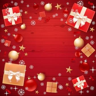 Szablon kartki świąteczne, ulotka, plakat, zaproszenie na obiad, baner na plakat promocyjny. z bombkami, gwiazdkami, pudełkami i copyspace. czerwony drewniany.