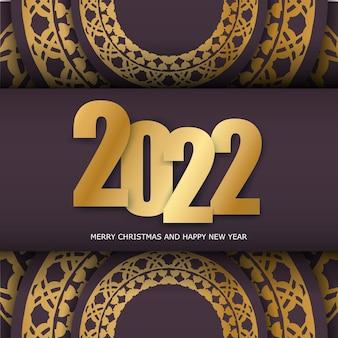 Szablon karty z pozdrowieniami 2022 szczęśliwego nowego roku w kolorze bordowym z zimowym złotym ornamentem