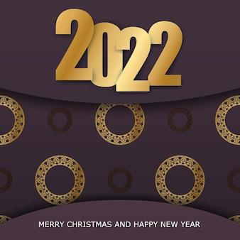 Szablon karty z pozdrowieniami 2022 szczęśliwego nowego roku w kolorze bordowym z zimowym złotym wzorem