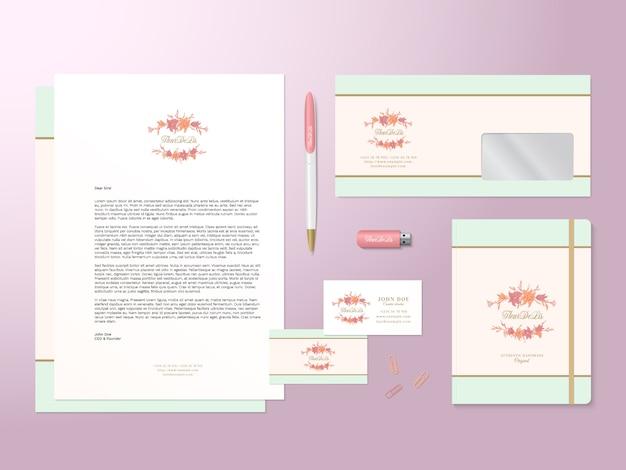 Szablon logo lilie i realistyczny zestaw stacjonarny z miękkimi cieniami. dobry jako szablon lub makieta tożsamości biznesowej.