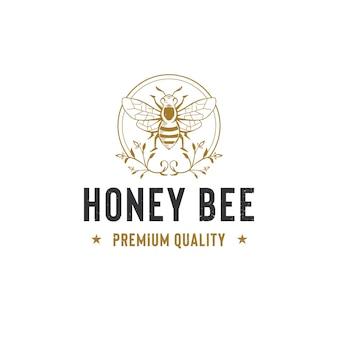 Szablon logo pszczoły miodnej na białym tle