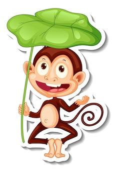 Szablon naklejki z małpą trzymającą liść na białym tle
