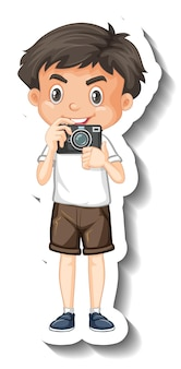 Szablon naklejki ze słodkim chłopcem trzymającym postać z kreskówek z aparatem