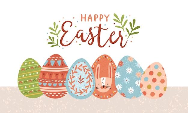 Szablon pocztówki z napisem wesołych świąt odręcznie kaligraficznym skryptem i kolorowymi ozdobnymi jajkami na białym tle.