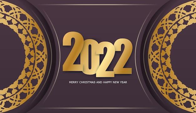 Szablon powitanie broszura 2022 wesołych świąt i szczęśliwego nowego roku bordowy kolor z zimowym złotym ornamentem