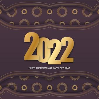 Szablon powitanie broszura 2022 wesołych świąt i szczęśliwego nowego roku bordowy kolor ze złotym wzorem vintage