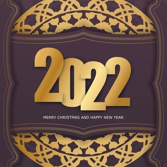 Szablon powitanie broszura 2022 wesołych świąt i szczęśliwego nowego roku w kolorze bordowym ze złotym ornamentem w stylu vintage