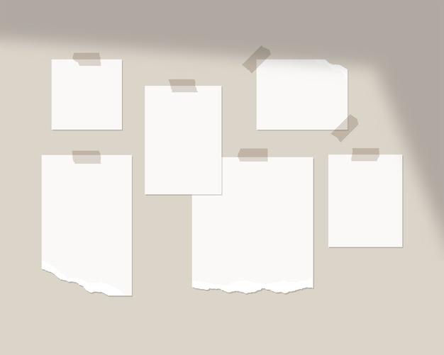 Szablon tablicy nastroju. puste arkusze białego papieru na ścianie z nakładką cienia. odosobniony. projekt szablonu. realistyczna ilustracja.