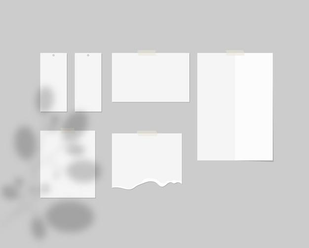 Szablon tablicy nastroju. puste arkusze białego papieru na ścianie z nakładką cienia. . szablon realistyczna ilustracja.