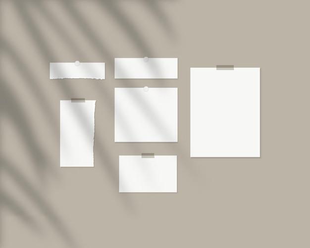 Szablon tablicy nastroju puste arkusze białego papieru na ścianie z nakładką cienia