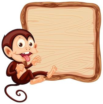 Szablon tablicy z uroczą małpą na białym tle