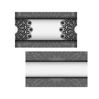 Szablon wektor zaproszenia z miejscem na twój tekst i czarne ozdoby. projekt pocztówki białe kolory z ornamentem mandali.