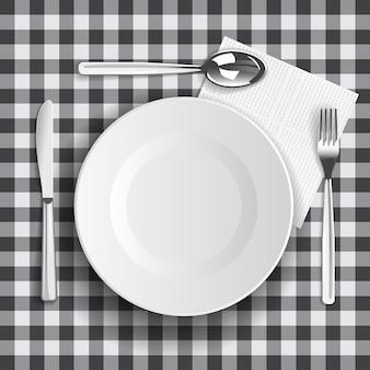 Szablon z terminami przy stole i pusty talerz.