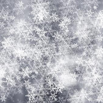 Szare tło mróz z płatki śniegu