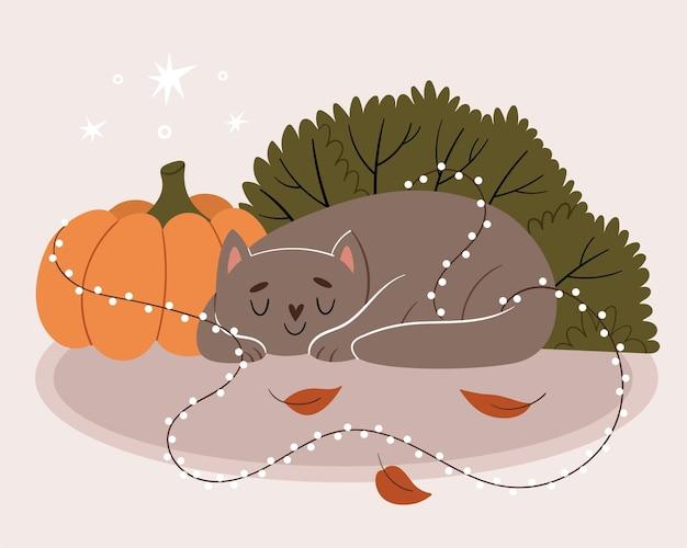 Szary kot śpi w pobliżu dyni. kot jest zaplątany w sylwestrową girlandę. jesienny nastrój.