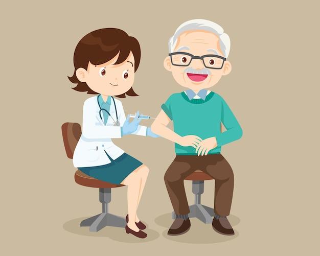 Szczepionka do wstrzykiwania lekarza dla starszego mężczyzny