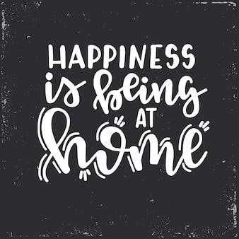 Szczęście jest w domu ręcznie rysowane plakat typografii. koncepcyjne zwrot odręczny domu i rodziny, ręcznie napisane kaligraficzne projekt. literowanie.
