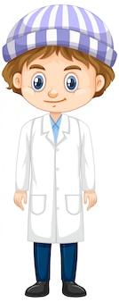 Szczęśliwa chłopiec jest ubranym lab togę na bielu