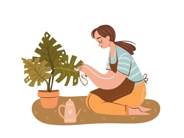 Szczęśliwa dama roślin młoda kobieta miłośniczka roślin opiekująca się rośliną doniczkową dziewczyna z doniczkową rośliną monstera