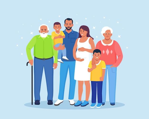 Szczęśliwa duża rodzina stojąc razem. babcia, dziadek, mama, tata, dzieci. uśmiechnięci krewni zbierają się w grupie. relacja wielopokoleniowa