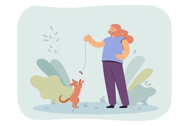Szczęśliwa dziewczyna bawi się kotem z płaską ilustracją łuku