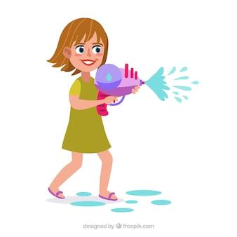 Szczęśliwa dziewczyna bawić się z wodnym pistoletem