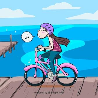 Szczęśliwa dziewczyna jeździć na rowerze i gwiżdżąc