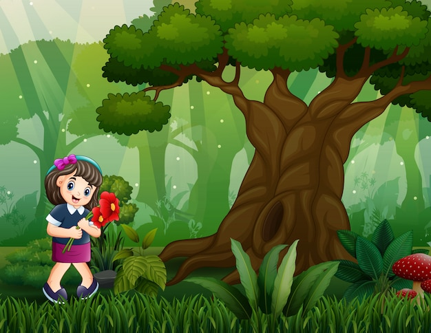 Szczęśliwa dziewczyna podnosi kwiaty w drewnach