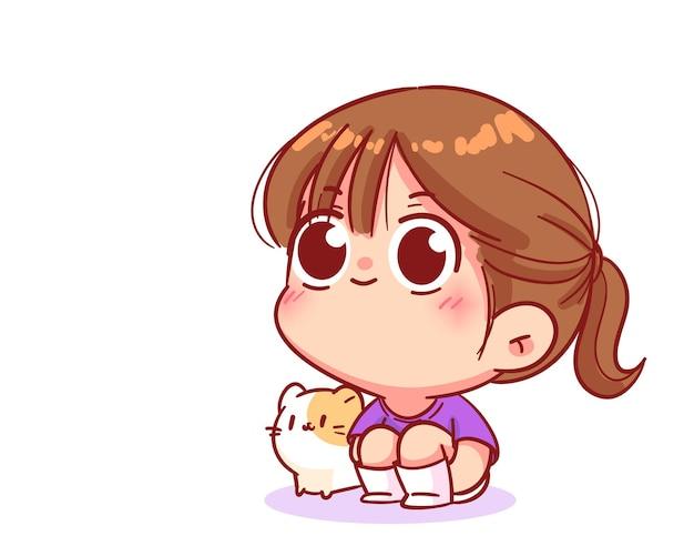 Szczęśliwa dziewczyna siedząca na podłodze przytulająca kolana z ilustracją kreskówki kota
