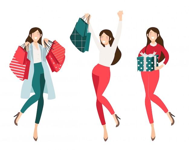 Szczęśliwa dziewczyna zakupoholiczki zakupy na boże narodzenie kolekcji